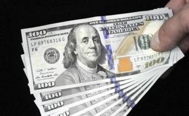 El dólar oficial marca un nuevo récord y se acerca a los $15