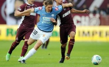 Belgrano empató y sigue en carrera