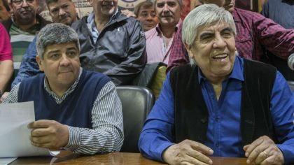 Hugo y Pablo Moyano pedirán reabrir las paritarias de Camioneros